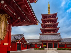 Japan. Asakusa Temple in Tokyo. Japanese pagoda on the background of blue sky. Sights of Tokyo. Sensoji Temple in sunny weather. Buddhist temple in Japan. Red Pagoda. Japan traditional.
