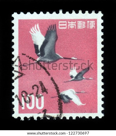 JAPAN - CIRCA 1963:A post stamp printed in Japan and shows japanese (manchurian) cranes, red-crowned crane (grus japonensis), flight of birds, circa 1963