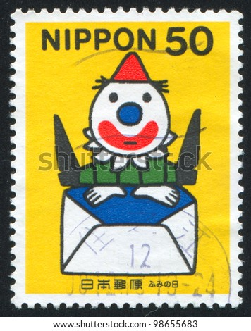JAPAN - CIRCA 1999: A stamp printed by Japan, shows Clown with yellow hat, jumping up out of envelope, circa 1999
