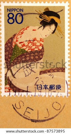 JAPAN - CIRCA 2000: A stamp printed in japan shows Geisha, circa 2000