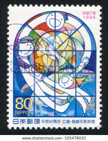 JAPAN - CIRCA 1995: stamp printed by Japan shows Children holding hands behind stained glass window, peace dove, earth from space, circa 1995