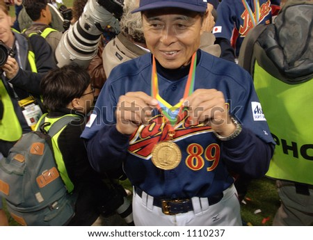 Japan coach Sadaharu Oh displays his gold medal earned for winning the 2006 World Baseball Classic after they defeated Cuba 10-6 at Petco Park in San Diego March 20, 2006.