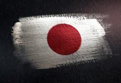 Japan Flag Made of Metallic Brush Paint on Grunge Dark Wall