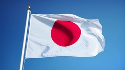 Japan flag waving against clean blue sky, close up, isolated with clipping path mask alpha channel transparency