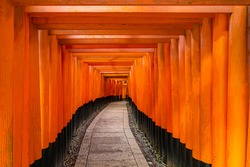 Japan. Fushimi Inari in Kyoto. Sanctuary of a thousand red gates. Orange arches on the way to the temple. Red arches at entrance to a temple in Japan. Path to the temple in Kyoto. Tourism in Japan