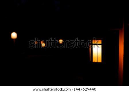 Japan garden in dark night with lantern illuminated lamps light in garden with golden yellow illumination color #1447629440