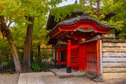 Japan. Gateway to a small temple in Tokyo. Buddhist temples in the Japanese capital. Red Gate to the Japanese Church. Tokyo in autumn day. Architecture in Japan. Guide to Tokyo. Religion