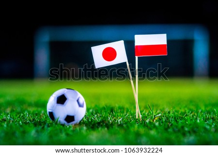 Japan - Poland, Group H, Thursday, 28. June, Football, National Flags on green grass, white football ball on ground. #1063932224