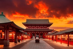 Japan, Tokyo. Asakusa Temple in red. Sensoji Temple under red sky. Buddhism concept. Buddhist temple without people. Asakusa Street with souvenir shops. Hand washing bowl in front of Buddhist temple