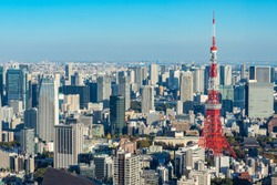 Japan. Tokyo. Tokyo Television Tower rises above the city. Panorama of Tokyo with a television tower. Japanese city top view. Red television tower. Sights of Japan. Japanese city landscape.
