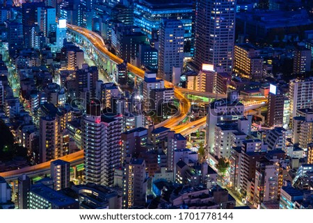 Japan. View of Tokyo from a height. Evening in the Japanese capital. Tokyo highway, residential buildings and business centers. Evening in the big city. Cities of Japan. Stock foto ©