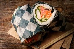 Japanese-American cuisine fusion sushi burrito with spicy tuna and shrimp