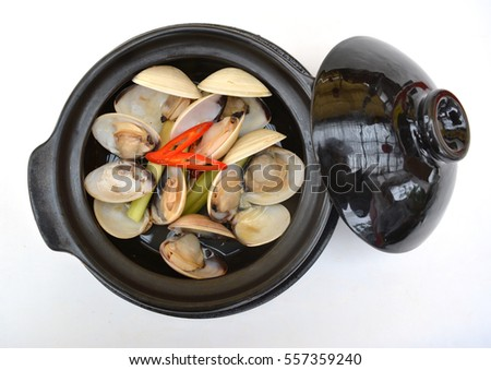 Japanese asari clams steamed in black pot, isolated on white background Сток-фото ©