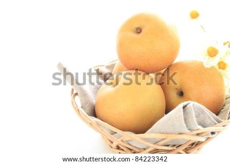 Japanese autumn fruit, pear on basket