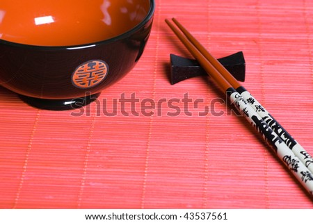 Japanese bowl and sticks. Eastern style.