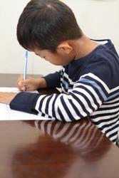 Japanese boy doing homework (second grade at elementary school)