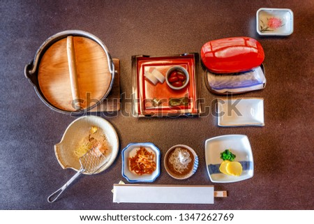 Japanese breakfast. A lot of small portions of different national dishes served in traditional Japanese style. Top view.