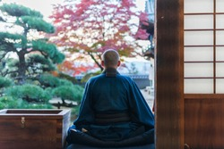 Japanese Buddhist Monk and autumn leaves