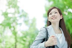 Japanese business woman walking outside