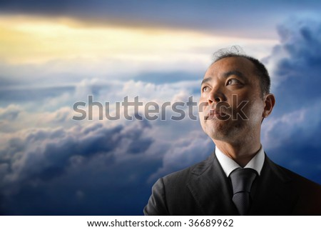 japanese businessman against a cloudy sky