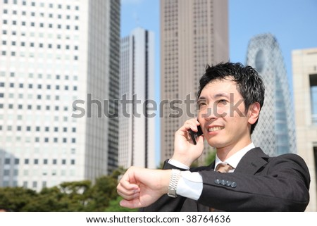 japanese businessman talks with a mobile phone