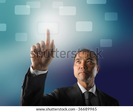 japanese businessman touching a digital button