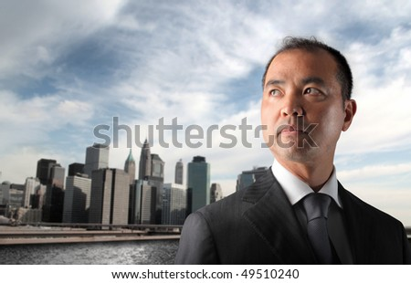 Japanese businessman with cityscape on the background