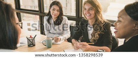 Japanese businesswoman having a meeting with international team, diverse female leader concept, banner size #1358298539