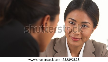 Japanese businesswoman talking with Mexican colleague #232893838