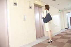 Japanese businesswoman waiting for the elevator