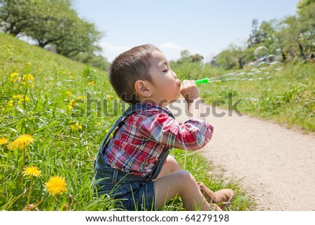 Japanese children blow bubbles