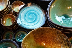 Japanese colorful dishes at shop in Kappabashi, Tokyo, Japan. Shiney blue, green and brown colors are beautiful.