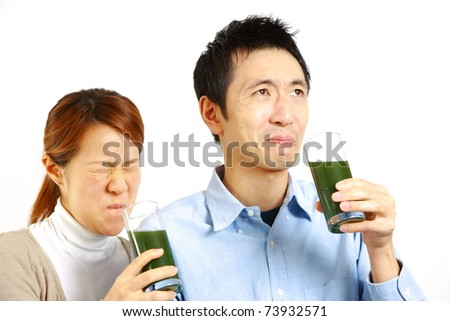 Japanese couple having green vegetable juice