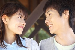 Japanese Couple staring into each other eyes