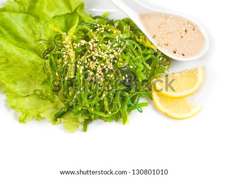 Japanese Cuisine - Chuka Seaweed Salad with Nuts Sauce. Served with Lemon and Sesame