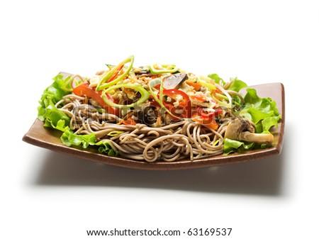 Japanese Cuisine - Fried Noodles with Vegetables and Eggs. Garnished on Salad Leaf