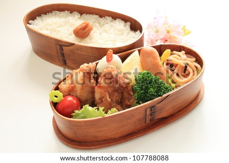 Japanese cuisine homemade packed lunch, fried chicken and vegetable
