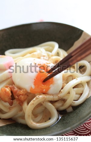 japanese cuisine, hot spring poached egg with kamaboko on udon noodle