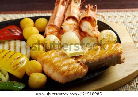 Japanese cuisine .Salmon Steak with royal prawn