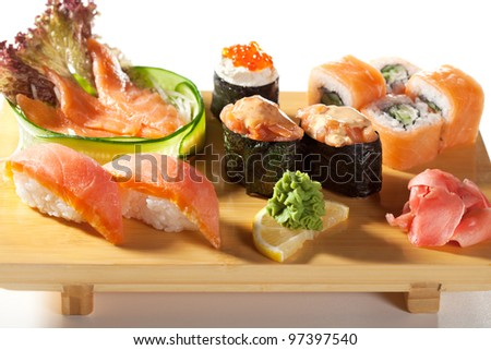 Japanese Cuisine - Salmon Sushi Set. Nigiri and Sashimi with Gunkan Maki Sushi with Red Roe