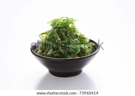 Japanese Cuisine , Seaweed Salad in black bowl on white background