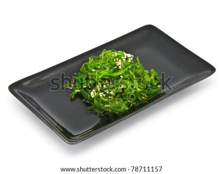 Japanese Cuisine , Seaweed Salad in black plate on white background