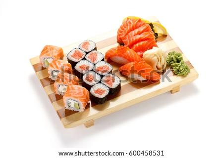Japanese cuisine. Sushi and rolls set isolated on white background.