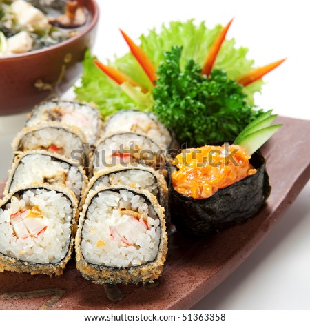 Japanese Cuisine -Tempura Maki Sushi (Deep Fried Roll made of Smoked Eel, Crab Meat and Cream Cheese inside) with Spicy Salmon (sake) Gunkan Sushi and Miso Soup (Seaweed, Mushrooms and Tofu Cheese)