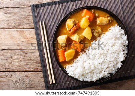 Japanese curry rice with meat, carrot and potato close-up on a plate on a table. horizontal top view from above ストックフォト ©