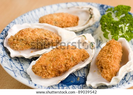 Japanese deep fried breadcrumbed oysters in a half shell