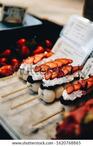 Japanese desserts selling by the streets. Strawberry Daifuku