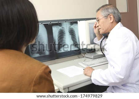 Japanese Doctor looking at xrays