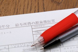 Japanese documents. Translation: employment income, withholding tax, beneficiary number, title, name, amount after deduction of employment income, withholding tax, number of disabled persons.