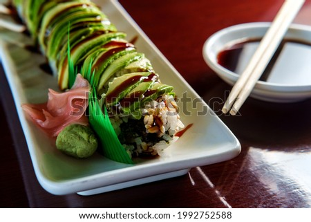 Japanese eel avacado dragon roll with wasabi and pickled ginger